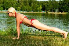 Free Girl In Bikini Doing Exercises Royalty Free Stock Photos - 15401688