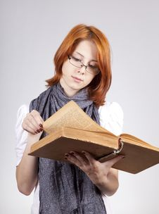 Free Doubting Girl In Glasses With Old Book Royalty Free Stock Photos - 15402188