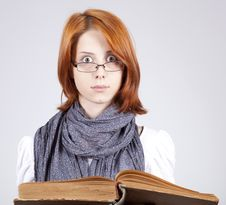 Doubting Girl In Glasses With Old Book Stock Images