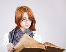 Free Doubting Girl In Glasses With Old Book Royalty Free Stock Images - 15402209