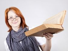 Free Young Girl In Glasses With Age Book. Royalty Free Stock Photo - 15402225