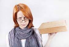 Young Girl In Glasses With Age Book. Stock Photography