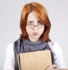 Free Doubting Fashion Girl In Glasses With Old Book Royalty Free Stock Photo - 15402265