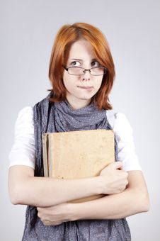 Free Doubting Fashion Girl In Glasses With Old Book Royalty Free Stock Image - 15402276