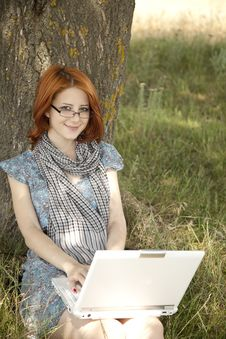 Free Young Smiling Girl In Glasses And Notebook Royalty Free Stock Photo - 15402505