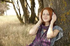 Free Young Smiling Girl With Headphones Near Tree. Stock Photos - 15402513