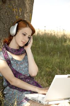 Free Young Smiling Girl With Notebook And Headphones Royalty Free Stock Images - 15402539