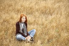 Free Beautiful Red-haired Girl At Yellow Autumn Grass. Stock Photography - 15402722