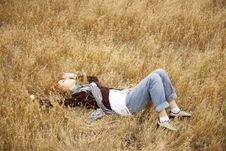 Free Young Beautiful Girl Lying At Yellow Autumn Field. Stock Images - 15402854