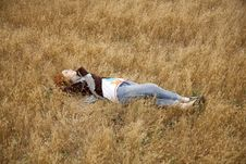 Free Young Beautiful Girl Lying At Yellow Autumn Field. Stock Photos - 15402913