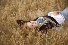 Free Young Beautiful Girl Lying At Yellow Autumn Field. Stock Photos - 15402993