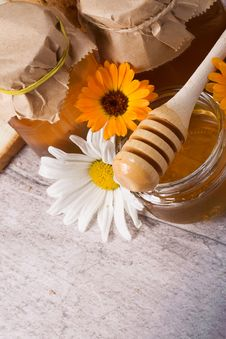 Free Flowers And Honey On Table Stock Image - 15403081