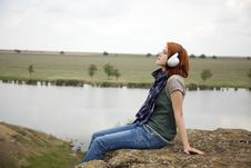 Young Girl With Headphones At Rock Royalty Free Stock Images