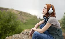 Young Girl With Headphones At Rock Stock Photo