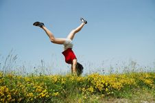 Free Young Woman Doing A Cartwheel In A Meadow Royalty Free Stock Photos - 15406538