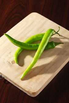 Free Chilis On Wooden Chopping Board Stock Photos - 15409143