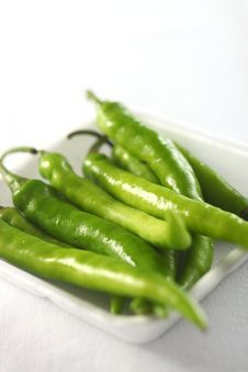Green Chilis On White Royalty Free Stock Images