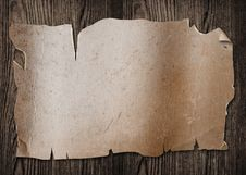 Free Old Paper On Wood. Royalty Free Stock Photography - 15413497