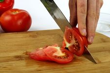 Cutting Tomato Stock Photography