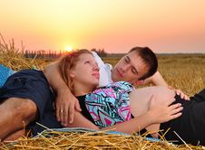 Free The Pregnant Girl And The Guy On Sunset Stock Photography - 15417062