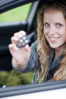Free Pretty Young Woman Showing Off Her Brand Car Royalty Free Stock Photography - 15418897