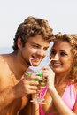 Free Young Couple On The Seaside With Cocktails Royalty Free Stock Photography - 15421487