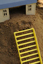 Free Toy House With Ladder On Sand Royalty Free Stock Image - 15424126
