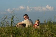 Free Father With Daughter Sit On Meadow Stock Photography - 15420022