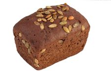Loaf Of Granary Brown Bread On A White Background Stock Images