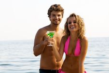 Free Young Couple On The Seaside With Cocktails Stock Images - 15421484