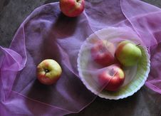 Still Life By Apples And Pink Fabric Royalty Free Stock Image