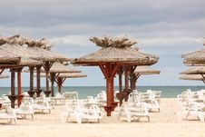 Free Beach With Deckchairs And Parasols Sea Royalty Free Stock Photos - 15422018