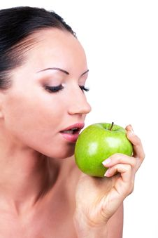 Free Beautiful Woman With Green Apple In Hand Stock Image - 15423011