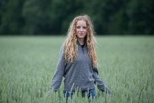 Free Young Woman Standing In A Green Field Royalty Free Stock Images - 15423099