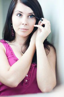 Free Pretty Young Woman Applying Mascara /eye Shadows Stock Image - 15424611