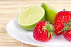 Free Strawberries And Limes On White Plate Stock Image - 15424641