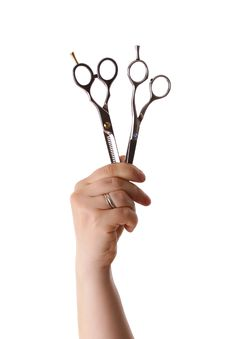 Two Scissors In The Hand Royalty Free Stock Images