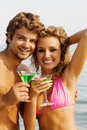 Free Young Couple With Cocktails On The Seaside Stock Photos - 15437423