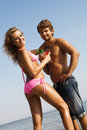 Free Young Couple With Cocktails On The Seaside Stock Photography - 15437432