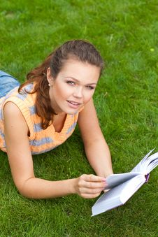 Free Girl With Book On Grass Royalty Free Stock Image - 15431756