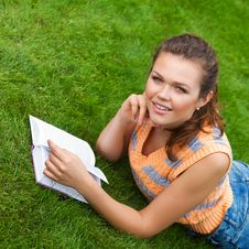 Teenager On Grass Royalty Free Stock Images