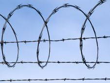 Free Barbed Wire Fence Against Blue Sky Stock Photo - 15431970