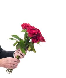 Free Bouquet Of Red Roses Offered By Man Stock Photo - 15432110
