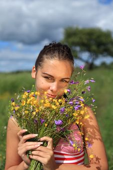 Free Beautiful Girl Is Gathering Bouquet Of Wildflowers Royalty Free Stock Photos - 15434198