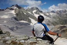 Man Looking To A Mountain Peak Stock Photos
