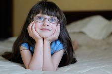 Nice Dreaming Toddler Girl With Long Dark Hair Stock Photo