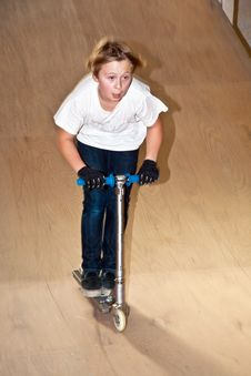 Free Boy With Scooter In Skate Hall Stock Photo - 15435560