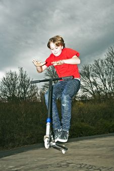Boy Going Airborne With A Scooter Stock Images