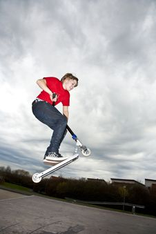 Free Boy Going Airborne With A Scooter Royalty Free Stock Photo - 15436025