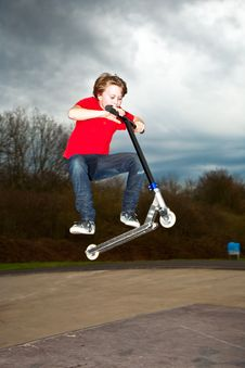 Boy With Scooter At The Skate Parc Stock Image
